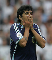 Argentine midfielder (22) Luis Gonzalez reacts to a missed shot in the second half.  Germany defeated Argentina on penalty kicks after leaving the scored tied in regulation, 1-1,  in their FIFA World Cup quarterfinal match at FIFA World Cup Stadium in Berlin, Germany, June 30, 2006.