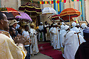 19/01/12. Addis Ababa, Ethiopia. The festival of Timket is celebrated in Addis Ababa, Ethiopia. Numerous parades start at many churches, carrying their replica Arks of the Covenant, accompanied by drumming, singing, harps and ullulation, through the city to Jan Meda. Jan Meda is the place where the baptism of Jesus is commemorated by Orthodox Christian Ethiopians. Picture shows priests and deacons outside St Mary's church. Photo credit: Jane Hobson