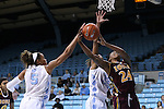 21 November 2015: Iona's Joy Adams (24) is defended by North Carolina's N'Dea Bryant (22) and Stephanie Watts (5). The University of North Carolina Tar Heels hosted the Iona College Gaels at Carmichael Arena in Chapel Hill, North Carolina in a 2015-16 NCAA Division I Women's Basketball game. UNC won the game 64-52.