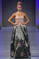 Model walks runway in an outfit by Romanita Claudia Iovan, for the Romanitza fashion show, celebrating her 20th anniversary in fashion; during Couture Fashion Week, September 16, 2011.