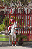 SOLDIER on horseback guards the CITY PALACE of UDAIPUR: Maharaja Udai Singh ll istarted construction in 1600 AD - RAJASTHAN, INDIA