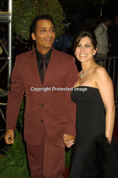 ©2003 AURA BLANDINO/HUTCHINS PHOTO.Premio Lo Nuestro Music Awards.February 5th, 2003.James Knight Center.Miami, FL .JON SECADA AND MARITERE