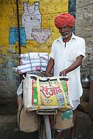 Plastic cup and nicknack salesman - Deoli, India