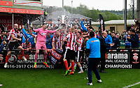 Lincoln City's Luke Waterfall lifts the Vanarama National League trophy <br /> <br /> Photographer Chris Vaughan/CameraSport<br /> <br /> Vanarama National League - Lincoln City v Macclesfield Town - Saturday 22nd April 2017 - Sincil Bank - Lincoln<br /> <br /> World Copyright &copy; 2017 CameraSport. All rights reserved. 43 Linden Ave. Countesthorpe. Leicester. England. LE8 5PG - Tel: +44 (0) 116 277 4147 - admin@camerasport.com - www.camerasport.com