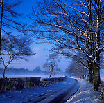Curving country lane in the snow, North Yorkshire, U.K