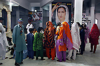 Celebrated young pakistani artist Asim Butt on a journey of political graffiti through Pakistan during the summer of 2009..At the Bhutto family mausoleam in Garhi Khuda Buxbhutto near lakana town people come and pay their respects to Benazir Bhutto