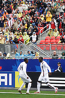 USA forward (12) Josmer Altidore celebrates scoring with defender (14) Anthony Wallace. Austria (AUT) defeated the United States (USA) in overtime of a FIFA U-20 World Cup quarter-final match at the National Soccer Stadium at Exhibition Place, Toronto, Ontario, Canada, on July 14, 2007.