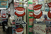"""In the old Saddar bazaar in Karachi, Pakistani dentists continue the tradition of street dentistry first bought to this city by Chinese immigrants.  Many such businesses continue to refer to themselves as 'China Destist"""" and some even retain the original Chinese names."""