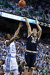05 February 2017: Notre Dame's Steve Vasturia (32) shoots over North Carolina's Kenny Williams (24). The University of North Carolina Tar Heels hosted the University of Notre Dame Fighting Irish at the Greensboro Coliseum in Greensboro, North Carolina in a 2016-17 Division I Men's Basketball game. The game had been postponed one day and moved from Chapel Hill due to a water shortage. UNC won the game 83-76.