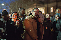 Namee Barakat, weeps with his wife Layla as they as they morn their son, Deah, with thousands of others who gathered for a vigil and memorial for three shooting victims at The Pit at The University of North Carolina at Chapel Hill in Chapel Hill, North Carolina on Wednesday, February 11, 2015. Craig Hicks, 46, of Chapel Hill has been charged with three counts of first-degree murder in the killings of Deah Barakat, 23, a UNC student; his wife, Yusor Abu-Salha, 21; and her sister, Razan Abu-Salha, 19. (Justin Cook)