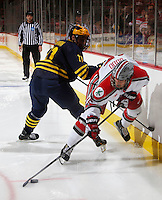 OSU Nick Oddo gets tripped up by Michigan's Zach Hyman in the second period at Value City Arena in Columbus Dec. 2, 2013.