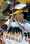 D.Salvatore Timberwolf Lamia dressing in traditional regalia, Tribal Ancestry: Shinnecock Indian Nation, Paukatuck Eastern Pequot. Intertribal Dancing a celebration of ethnic Native American pride and heritage  at Thunderbird Pow Wow..release <br /> # 2276, # 2452<br /> <br /> A pow-wow (also powwow or pow wow or pau wau) is a gathering of North America's Native people. The word derives from the Narragansett word powwaw, meaning &quot;spiritual leader&quot;.