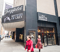"""The marquee of the Ziegfeld Theater in New York promotes the film """"Fifty Shades of Grey"""" on its opening weekend on Valentine's Day, Saturday, February 14, 2015. Analysts are predicting at least a $91 million box office over four-days possibly making it the highest grossing R-rated film in history. (© Richard B. Levine)"""