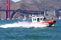 A Defender Class Response Boat (RB-S) searches patrols San Francisco Bay during 2008 Fleet Week activities. The RB-S was designed as a homeland security and law enforcement platform to conduct escorts, enforce security zones, and deliver boarding teams.