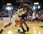 Ole MIss' Tia Faleru (32) drives vs. Northwestern State's Markeisha Johnson (23) in women's college basketball action in Oxford, Miss. on Friday, November 16, 2012.