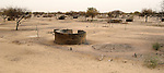 In the Darfur region of Sudan, the remnants of what were once thatched roof houses. This village was burned in an attack by pro-government Arab militias and Sudanese government troops.