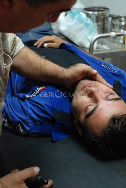 KIRKUK, IRAQ:  A wounded policeman lies in hospital after a bloody shootout with a gang of thieves...A shoot out between police and a gang of thieves left 10 dead and 16 wounded in the Iraqi city of Kirkuk.  The armed thieves were trying to rob a number of stores in the city's gold market when the police open fired on them...Photo by Hawre Khalid/Metrograpgy