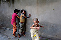 Girls running and playing in the backyard of the Arushi Shelter. New Delhi, India