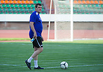 Tommy Wright watches training in the Neman Stadium in Grodno in Belarus where saints will play FC Minsk tomorrow night.<br /> Picture by Graeme Hart.<br /> Copyright Perthshire Picture Agency<br /> Tel: 01738 623350  Mobile: 07990 594431