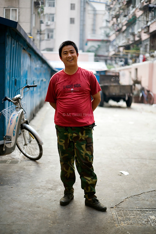 Zhoujiasong, who works in environmental protection, age 39, poses for a portrait in Nanjing. Response to 'What does China mean to you?': 'China is my home country. It doesn't matter where I am, I will always remember China.'  Response to 'What is China's role in the future?': 'My home country is grand. China will definitely become one of the world's superpowers.'