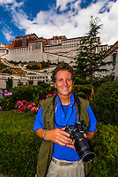 Photographer Blaine Harrington outside the Potala Palace, Lhasa, Tibet, China.