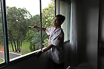 A man cleans a window in the Reunification Palace in Ho Chi Minh City, Vietnam. One of the biggest tourist draws in the former Saigon, the presidential palace for the U.S.-backed South Vietnamese government is kept scrupulously clean and is preserved much as it was on April 30, 1975, the day the regime fell. June 30, 2011.