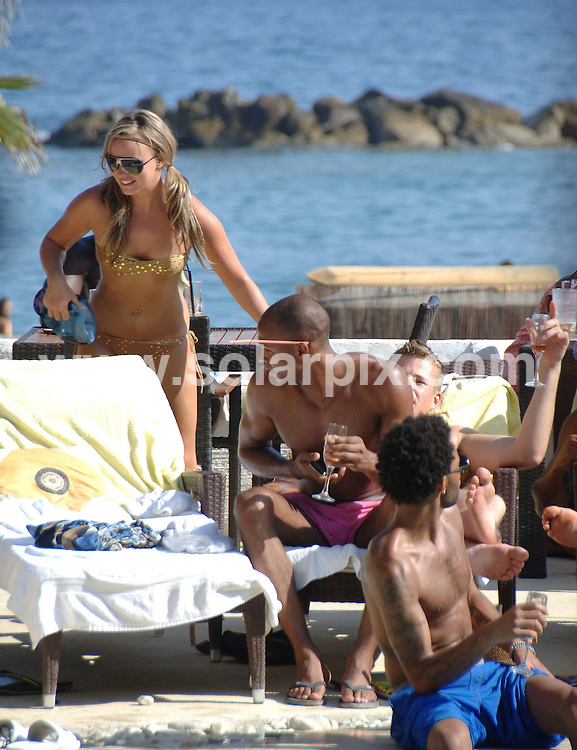 **ALL ROUND EXCLUSIVE PICTURES FROM SOLARPIX.COM**.**WORLDWIDE SYNDICATION RIGHTS**.Ex Big Brother Chanelle Hayes joined her friends Footballer Jermaine Pennant  & playboy Cullum Best for lunch a trendy Budhha Beach Club in Marbella ..Chanelle looked after the boys by putting sun cream on Jemaine and giving Cullum an eye full of her boobs..Chanelle has been in Marbella for the bank holiday recovering from her depression but by the looks of her she is doing just fine...This pic:Chanelle Hayes..JOB REF:  9834        JGS        DATE:31.08.09.**MUST CREDIT SOLARPIX.COM OR DOUBLE FEE WILL BE CHARGED**.**MUST AGREE FEE BEFORE ONLINE USAGE**.**CALL US ON: +34 952 811 768 or LOW RATE FROM UK 0844 617 7637**