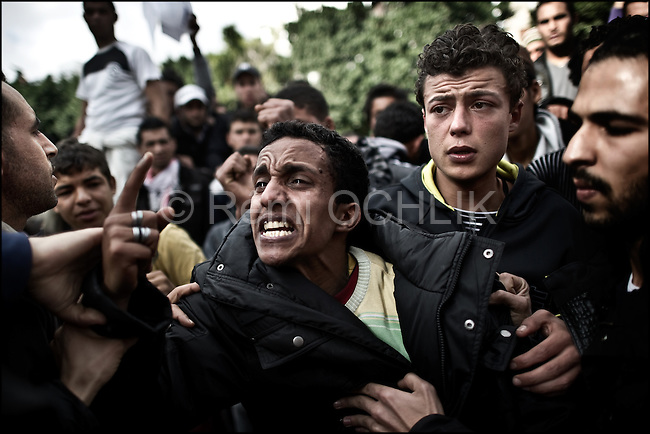 © Remi OCHLIK/IP3 - Tunis the 14 january 2011 - a young Tunisian protestor cry in front of the interior ministery because secret police tortured and killed his brother five year ago..Tunisia riots continued as President Zine El Abidine Ben Ali decided to dismiss his government following massive riots. The country's state news agency TAP says the president plans to call for new election in the next six months. Thousands of protestors took to the streets. The riots were sparked by high unemployment rates and a sagging economy as well as anger over government corruption. Tunisians enjoy little freedoms under President Zine El Abidine Ben Ali who has ruled a repressive regime for 23 years. Protestors ransacked buildings and threw rocks. Police used tear gas and gunshots to quell the crowd as protests got increasingly violent.