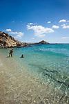 People enjoying beach on Mykonos Island in Greece