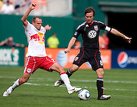 Carey Talley (8) of D.C. United tries to clear the ball away from Joel Lindpere (20) of the New York Red Bulls at RFK Stadium in Washington, DC.  The New York Red Bulls defeated D.CC United, 2-0.