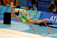 Aliya Yussupova competing for Kazakhstan split leaps with hoop during qualifications round at Athens Olympic Games on August 26, 2004 at Athens, Greece. (Photo by Tom Theobald)