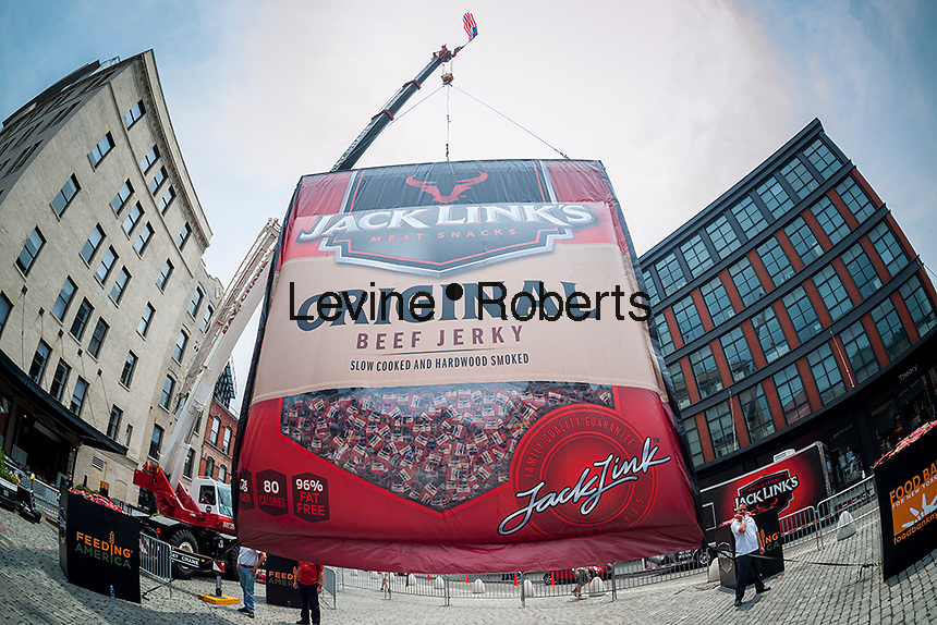"""A giant bag of Jack Link's brand beef jerky, 30 feet tall and 28 feet wide, is displayed in Gansevoort Plaza in the Meatpacking District of New York on Friday, June 12, 2015. The giant bag, named """"Meatzilla"""" was a promotion for the company on """"National Jerky Day"""" and Jack Link's will donate a ton of their processed meat product to the Food Bank For New York city. (© Richard B. Levine)"""