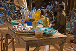 On sale in the Torodi, Niger market...peanuts, dates, cake, and traditional medicine. The rectangular sticks are traditional toothbrushes!