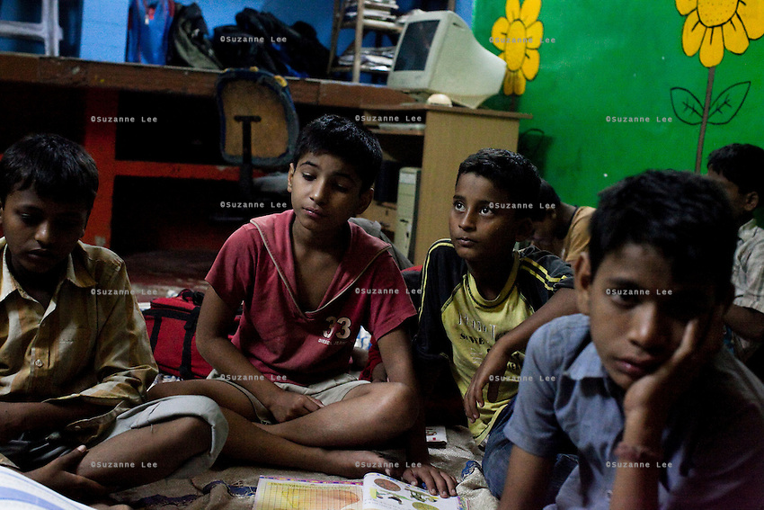 Homeless children who live at the Aashray Adhikar Abhiyan (AAA) Activity Center for homeless people study in a group on 4th October 2010, in Old Delhi, India. Picture: Suzanne Lee for The Australian.