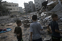 "August 23, 2014 - Gaza City, Gaza strip, Palestinian Territory: Palestinian children walk among the rubble of a house building after it was targeted by an airstrike in the Sabra neighborhood of Gaza City while ""Protective Edge"" Israeli military operation continues in the Gaza strip. (Narciso Contreras/Polaris)"