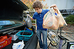 Taylor Lynch loads groceries he received from the Food Pantry of Urban Ministries of Wake County in Raleigh, North Carolina.