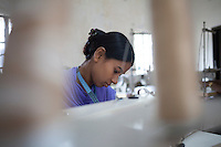 Shirin Akhter, 19,  survived the collapse of Rana Plaza on April 24, 2013. Shirin and another four survivors now work in a model garment factory called 'Oporajeo', a worker-owned factory in Savar, near Dhaka, Bangladesh