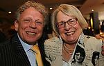Foto: VidiPhoto<br /> <br /> APELDOORN - Ds. R. van Kooten van de Hersteld Hervormde gemeente Apeldoorn is zaterdag geridderd. De versierselen behorend bij koninklijke onderscheiding Ridder in de Orde van Oranje-Nassau werden hem opgespeld door de loco-burgemeester van Apeldoorn Hans Brouwer. Ds. Van Kooten was zaterdag precies 40 jaar predikant. In zijn dankwoord noemde Van Kooten als meest ingrijpende gebeurtenis in zijn leven, de breuk in de Nederlandse Hervormde Kerk van 2004. Foto: Koos de Jong en Alie Hoek-van Kooten.