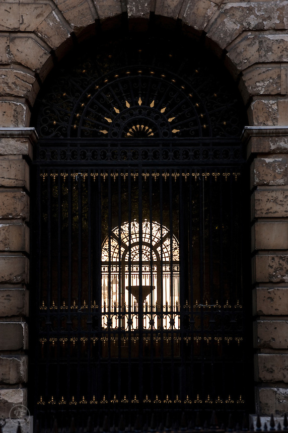 Looking through the splendid wrought-iron detail in the arches of Oxford's Radcliffe Camera.