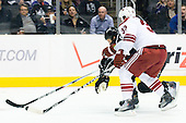 Kyle Clifford (Los Angeles Kings, #13) vs Adrian Aucoin (Phoenix Coyotes, #33) during ice-hockey match between Los Angeles Kings and Phoenix Coyotes in NHL league, March 3, 2011 at Staples Center, Los Angeles, USA. (Photo By Matic Klansek Velej / Sportida.com)