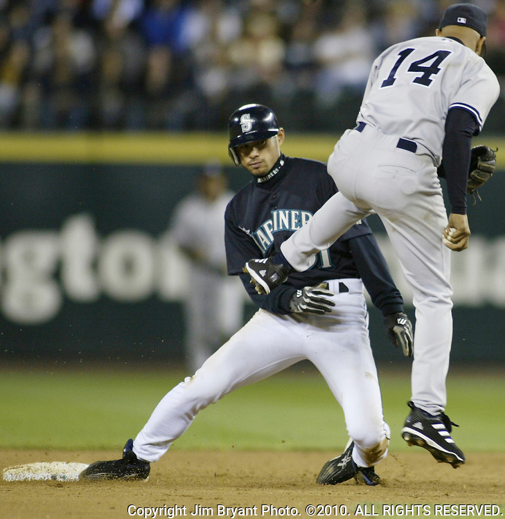 Seattle Mariners' Ichiro Suzuki breaks up a double play attempt by New York Yankees' second baseman Enrique Wilson in the 7th inning at Safeco Field on Friday, May 7, 2004 in Seattle, WA.     Jim Bryant Photo. ©2010. All Rights Reserved