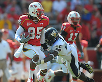 Torrey Smith of the Terrapins is brought down by FIU's defense. Maryland defeated FIU 42-28 during a game at Capital One Field at Byrd Stadium in College Park, MD on Saturday, September 25, 2010. Alan P. Santos/DC Sports Box