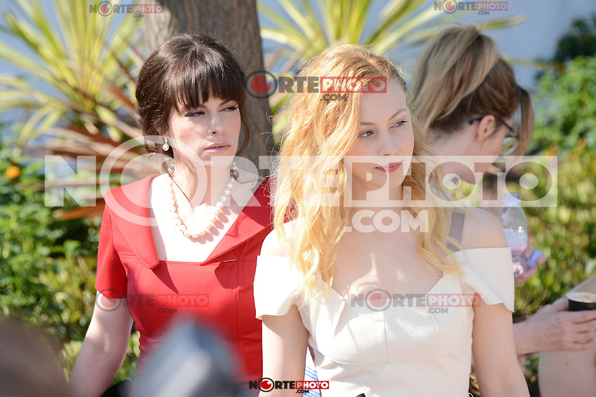 "Emily Hampshire and Sarah Gadon attending the ""Cosmopolis"" Photocall during the 65th Annual Cannes International Film Festival in Cannes, France, 25.05.2012...Credit: Timm/face to face /MediaPunch Inc. ***FOR USA ONLY***"