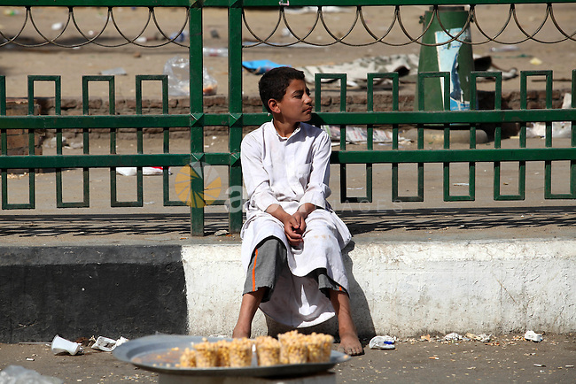 An Egyptian boy sells food in Cairo's landmark Tahrir Square on June 3, 2012 after a night of protests. Hundreds of demonstrators are occupying Tahrir Square after a court sentenced ousted president Hosni Mubarak and his interior minister Habib al-Adly to life in prison but acquitted six security chiefs in the deaths of protesters last year. Photo by Majdi Fathi