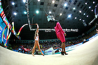 """Ines Gomes of Portugal walks to carpet with ribbon during seniors All-Around at 2007 World Cup Kiev, """"Deriugina Cup"""" in Kiev, Ukraine on March 17, 2007."""