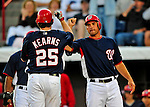 9 March 2009: Washington Nationals' third baseman Ryan Zimmerman (right) celebrates a home run by Austin Kearns during a Spring Training game against the Houston Astros at Space Coast Stadium in Viera, Florida. The Nationals defeated the Astros 8-6 in extra innings of the Grapefruit League matchup. Mandatory Photo Credit: Ed Wolfstein Photo
