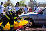 A firefighter participates in an Every 15 Minutes event at Mountain View High School April 17.