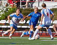 Boston Breakers forward Kyah Simon (17) dribbles the ball around Chicago Red Stars midfielder Jen Buczkowski (4) with Chicago Red Stars defender/midfielder Julianne Sitch (38) in pursuit.  The Boston Breakers beat the Chicago Red Stars 1-0 at Dilboy Stadium.