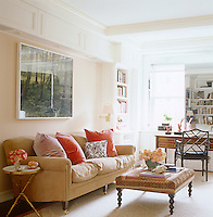 In the library a photograph by Ann Weathersby hangs above a comfortable George Smith sofa with a Chippendale-style chair at the Louis XVI mahogany desk