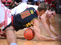 Ohio State Buckeyes guard Aaron Craft (4) and Maryland Terrapins guard/forward Jake Layman (10) dive for a loose ball in the second half of the college basketball game between the Ohio State Buckeyes and the Maryland Terrapins at the Jerome Schottenstein Center in Columbus, Wednesday evening, December 4, 2013. The Ohio State Buckeyes defeated the Maryland Terrapins 76 - 60. (The Columbus Dispatch / Eamon Queeney)